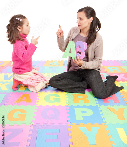Girl learning phonics alphabet abc
