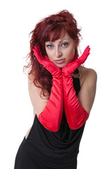 sexy young red-haired  in black evening dress and red gloves