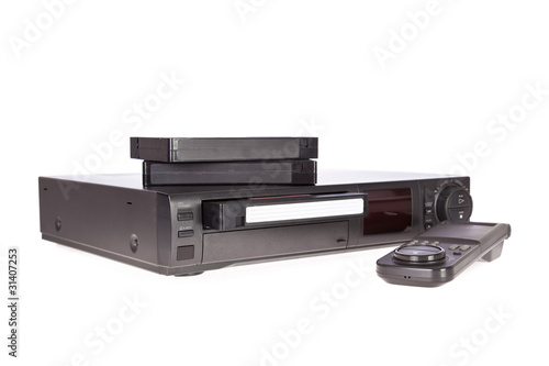 Old Video Cassette Recorder and tapes isolated on white