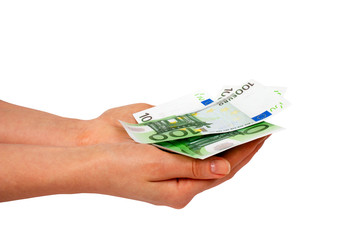 Euros on female's hands isolated on white background