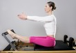 pilates reformer woman gym fitness teacher legs