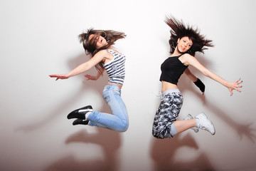 Two beautiful girls jumping