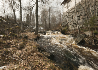 Spring flood running past old smeltery