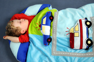 Close up of young boy dreaming of cars