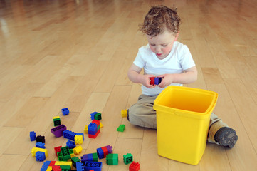 Young boy building with blocks
