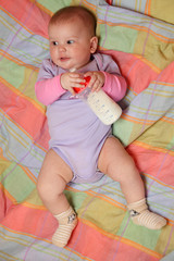 Little baby girl holding milk bottle