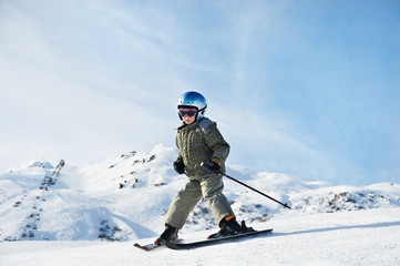 Small child skiing on snow slope