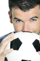 closeup of passionate soccer player with white and black balloon