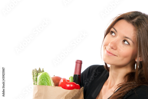 Close-up woman hold shopping paper bag full of vegetarian grocer