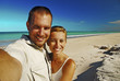 Couple Taking Photo On The Beach