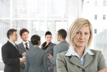 Smiling businesswoman in office lobby