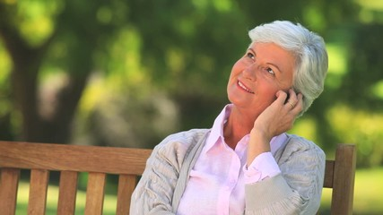 Mature woman having a phone conversation