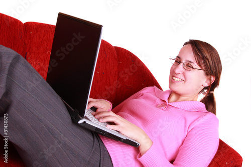 Young woman with notebook on couch