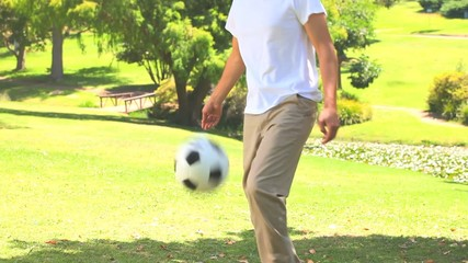 Young man playing with a ball outdoors