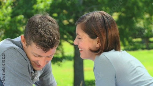 Loving young couple talking outside