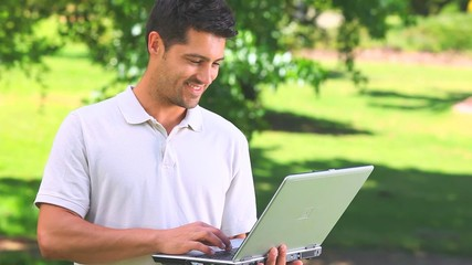 Young man chatting on his laptop