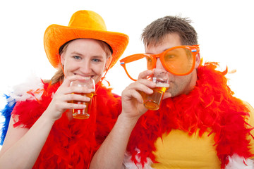Two Dutch soccer fans in orange outfit cheering for the WK games
