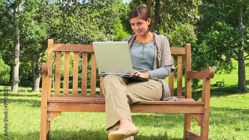 Young woman chatting on her laptop