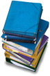A pile of ring binders and folders isolated