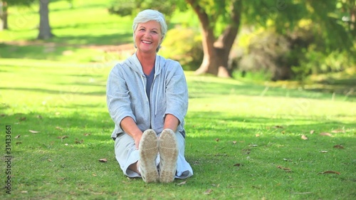Mature woman doing her stretches outdoors