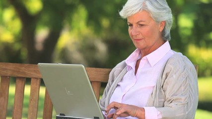Mature woman chatting on her laptop