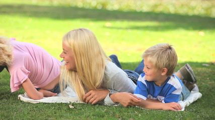 Young woman and her two children having fun