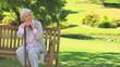Mature woman thinking while holding a walking stick