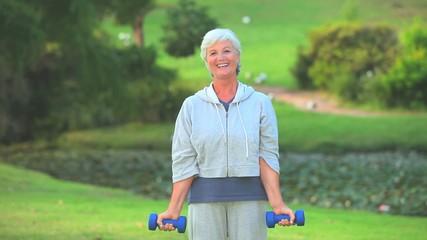 Mature woman bodybuilding outside