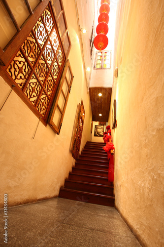 Chinese traditional corridor in wooden with red lantern.