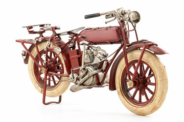 Handmade tin 1930's vintage motorcycle model, isolated