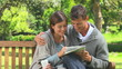 Young couple enjoying doing a crossword