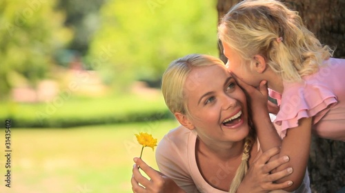 Young woman having fun with her daughter