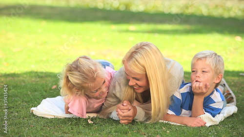 Young woman having fun with her two children