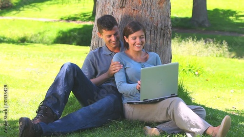 Young couple surfing on their laptop