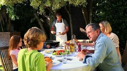 Family Barbecue in garden