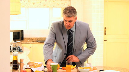 Man eating hurriedly before going to work