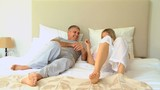 Young couple having fun on bed