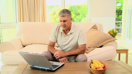 Man seeing disastrous news on his laptop