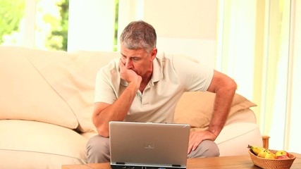 Man getting disastrous news on his computer