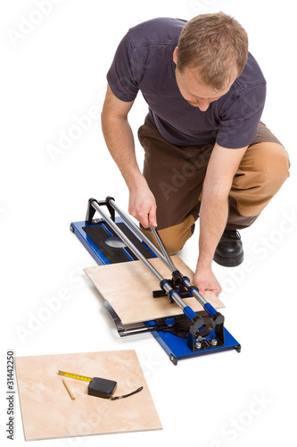 man cut tiles