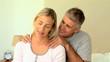 Man massaging his wife's shoulders