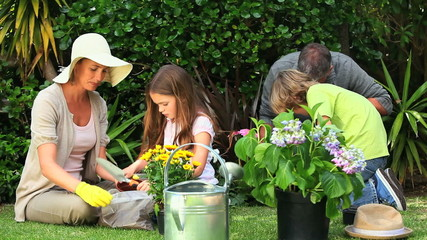 Parents with their children gardening