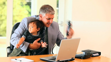 Businessman with his son having a lot of tasks