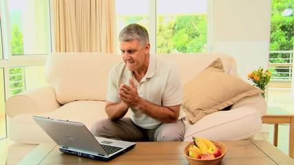 Man losing something on his laptop