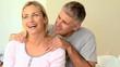 Man massaging his wifes shoulder