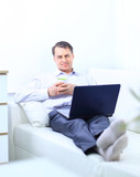 entrepreneur working from home looking very relaxed in poster