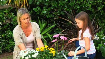 Mother gardening with her daughter