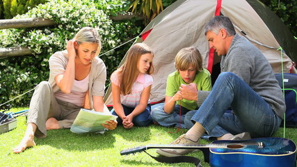 Family camping in a park