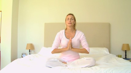 Blonde haired woman doing yoga