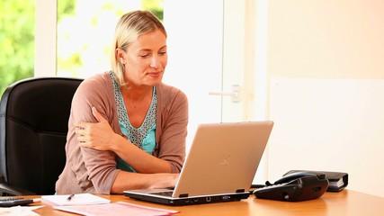 Blonde woman using a laptop